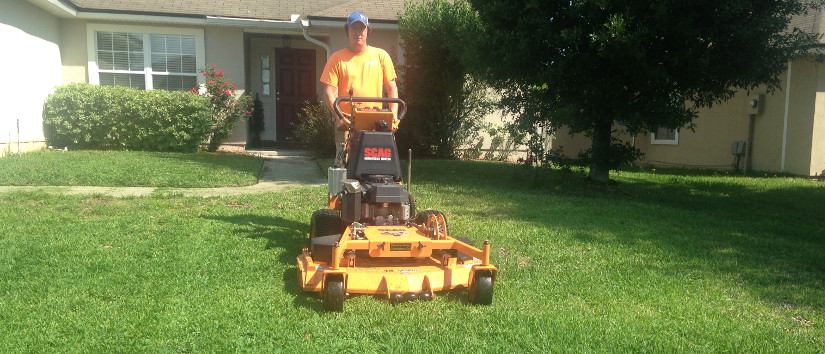 Brian with walk behind mower