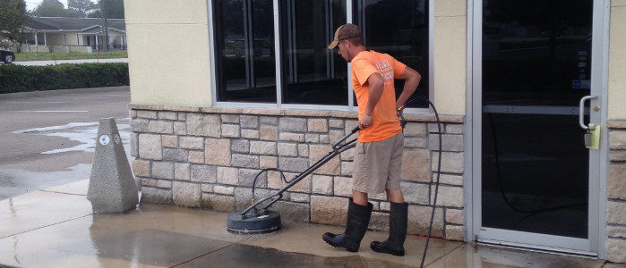 Jason cleaning concrete